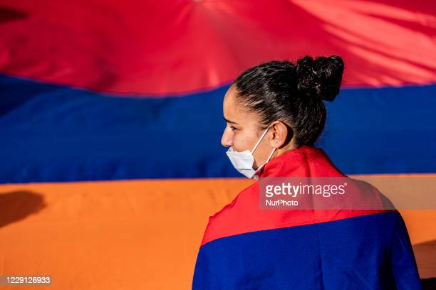 Girl with an armenian flag as a cape during a demonstration in Yerevan, Armenia, on October 16, 2020 for the recognition of Nagorno Karabakh as an...