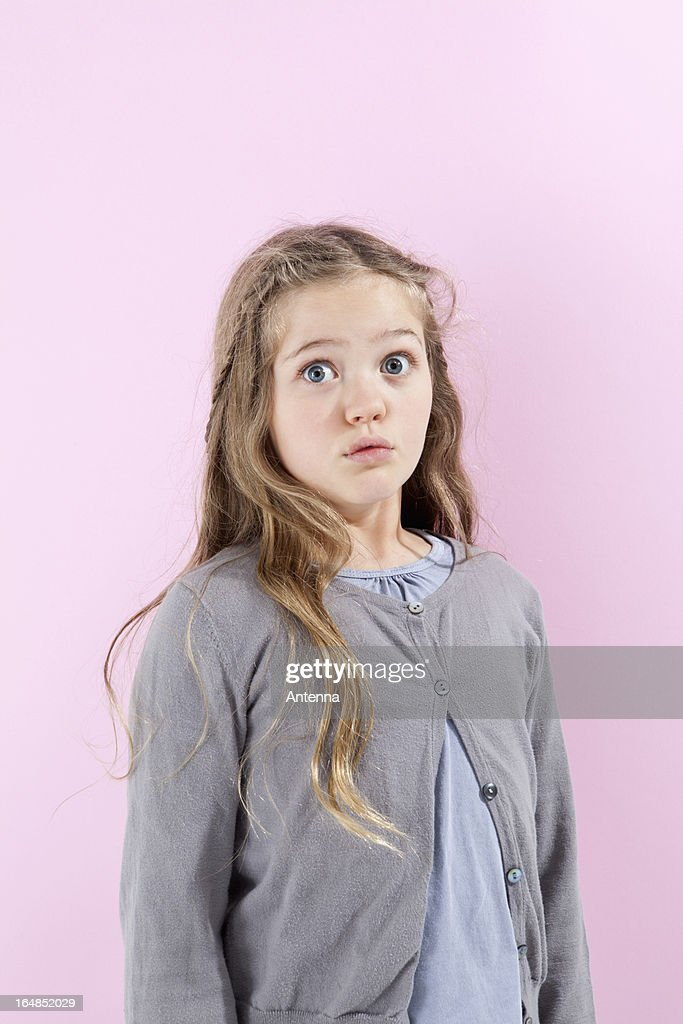A girl with an expression of disbelief on her face : Foto de stock