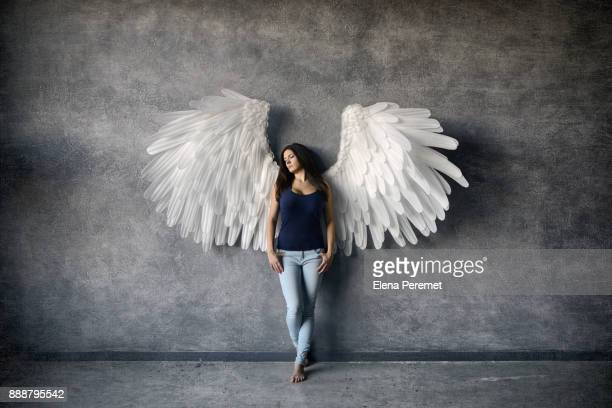 girl with angel wings - aile d'animal photos et images de collection