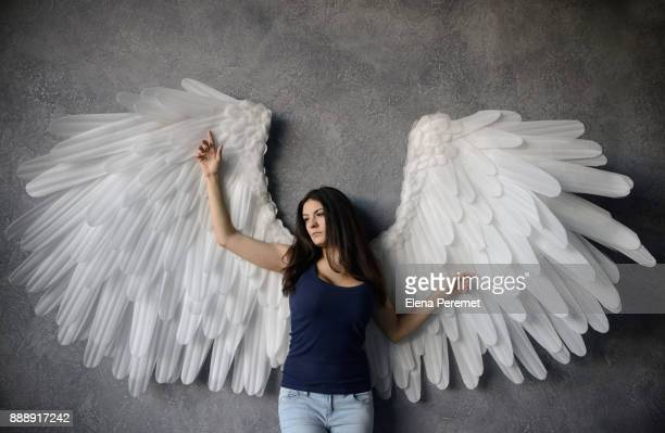 girl with angel wings - animal wing ストックフォトと画像