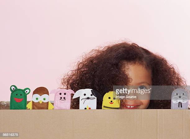 girl with animal finger puppets - puppet stock pictures, royalty-free photos & images