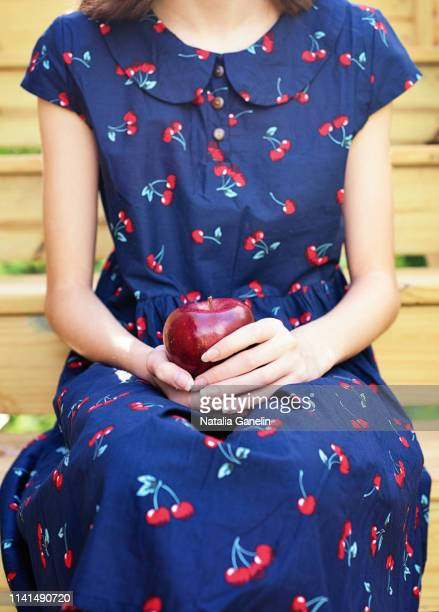 girl with apple - printed sleeve stock pictures, royalty-free photos & images