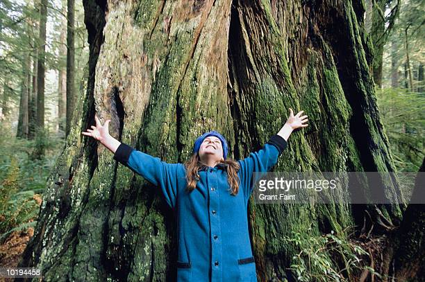 Girl (14-16) with arms extended in forest