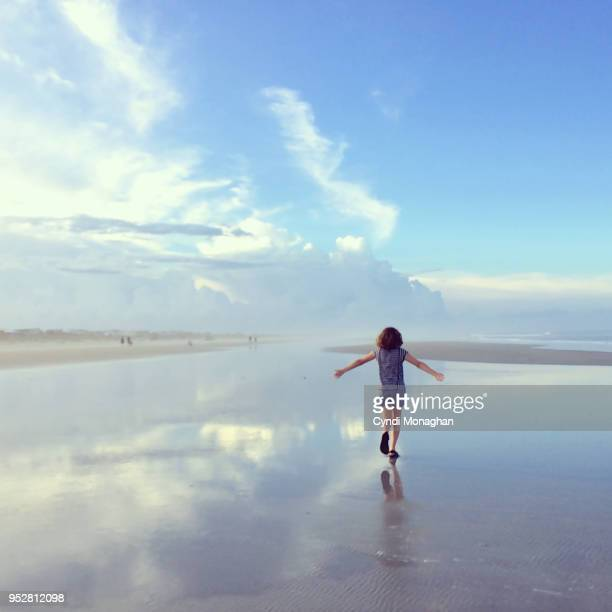 Girl with Arms Outstretched Like Wings