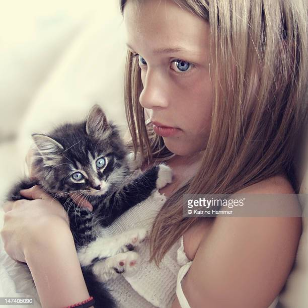 Girl with baby kitten