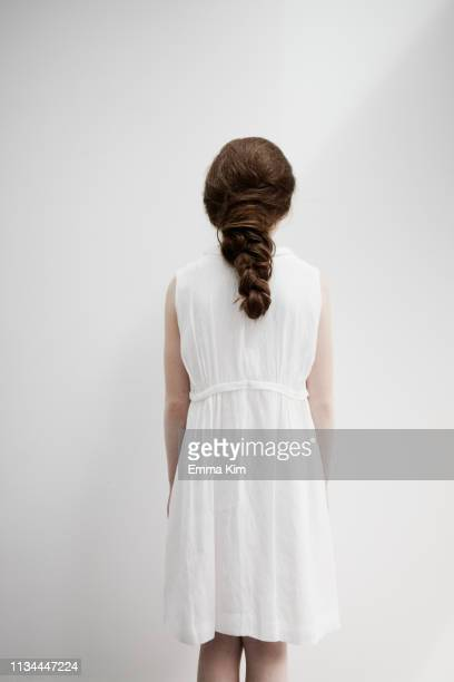 girl with back facing camera - girls flashing camera stock pictures, royalty-free photos & images