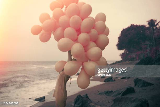 girl with ballons - pink dress stock pictures, royalty-free photos & images