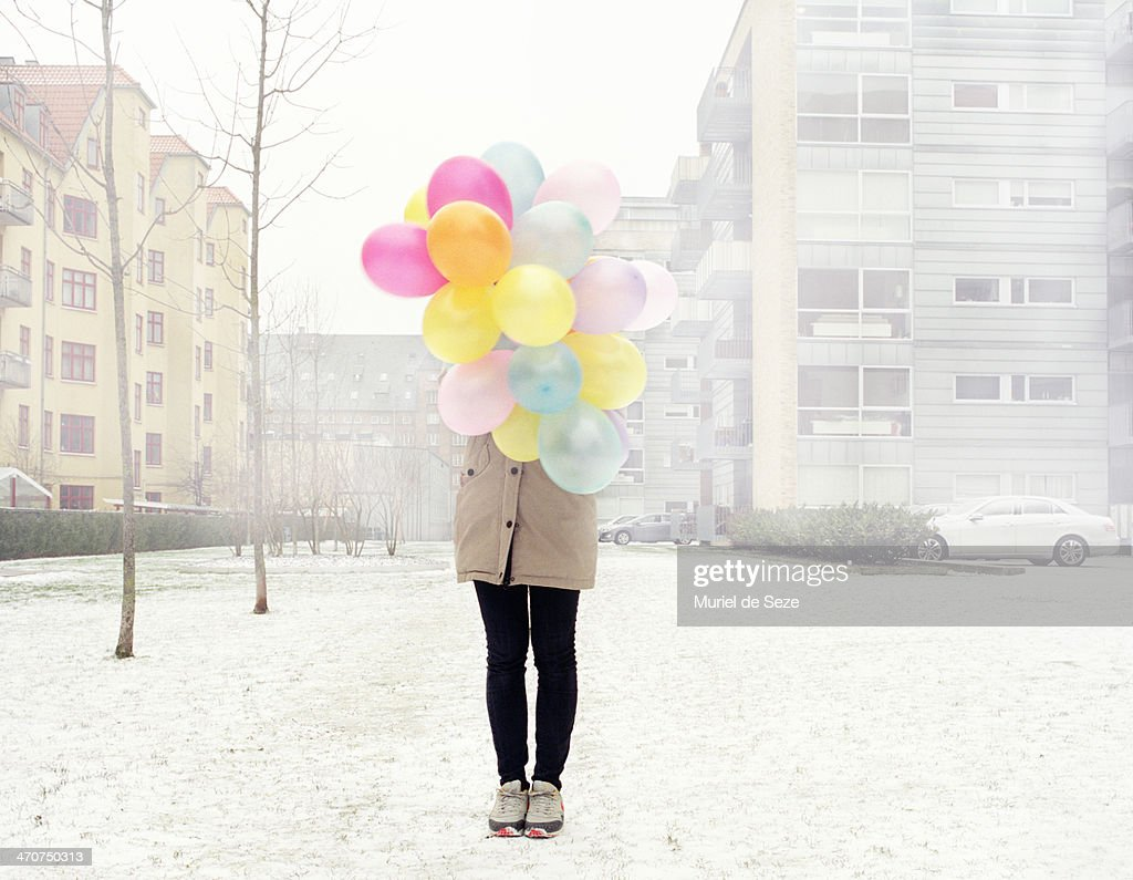 Girl with balloons in mist : Stock Photo
