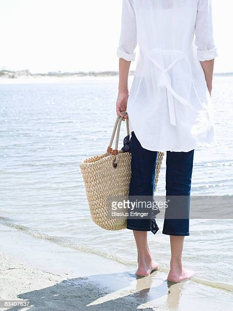 Girl with Basket on Beach