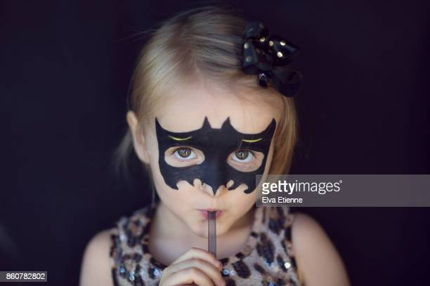 girl with bat shaped halloween face paints, drinking through a straw - naughty halloween stock photos and pictures