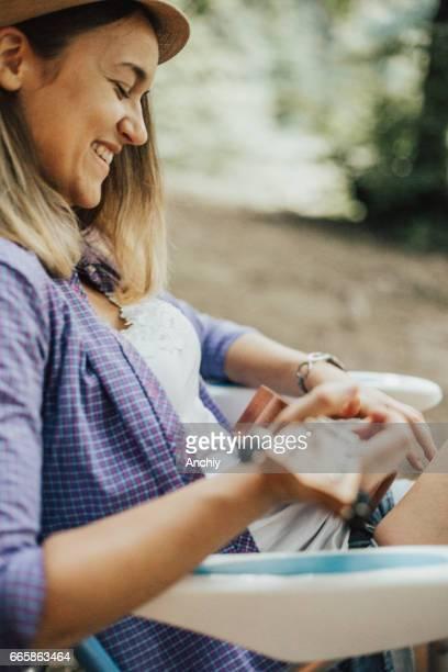 Girl with beautiful smile playing and ukulele