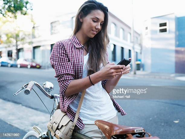 Girl with bicycle on phone