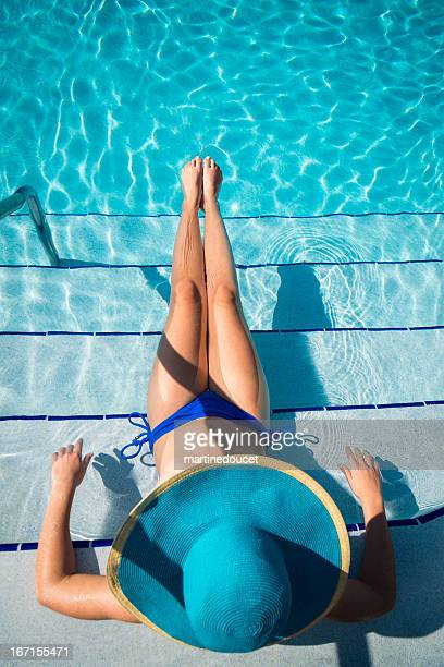 """girl with big blue hat enjoying vacations in pool - """"martine doucet"""" or martinedoucet stock pictures, royalty-free photos & images"""