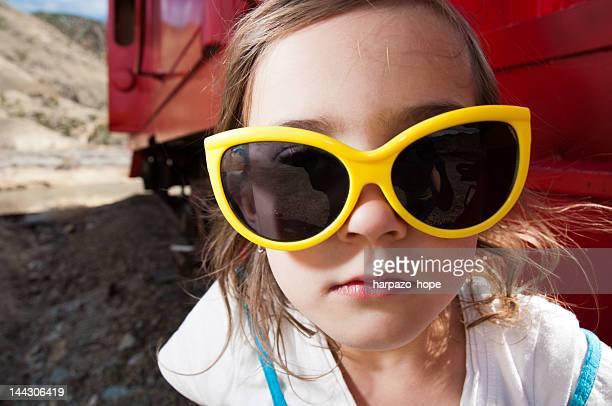Girl with big yellow glasses