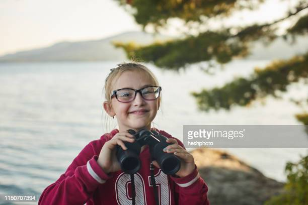 girl with binoculars - heshphoto stock pictures, royalty-free photos & images