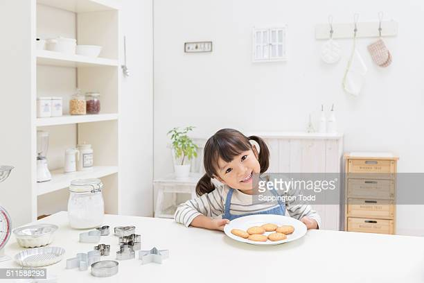 girl with biscuits - one girl only stock pictures, royalty-free photos & images