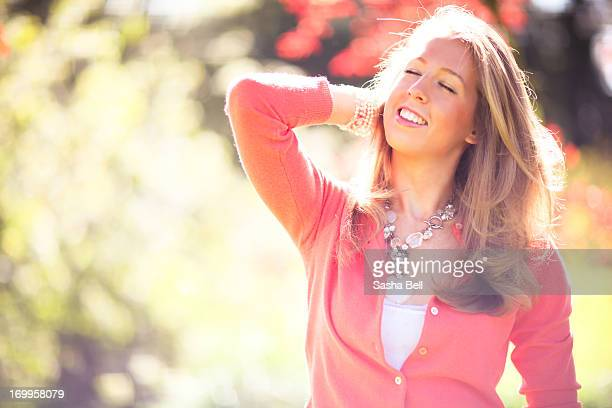 girl with blonde hair enjoying the spring sunlight - sasha gray stock photos and pictures
