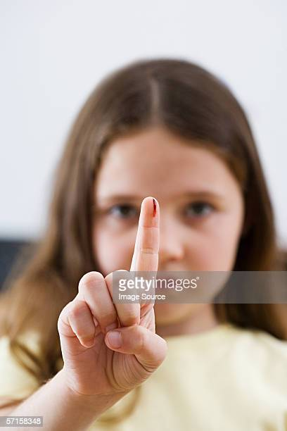 girl with blood on her finger - cut on finger stock photos and pictures