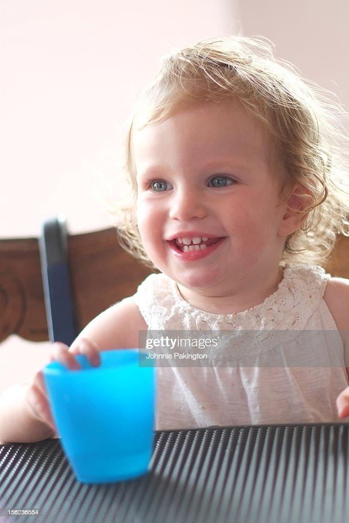 Girl with Blue Water Beaker : Stock Photo
