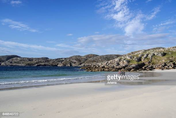 Girl with bodyboard on the beach at Achmelvich Sutherland Scottish Highlands Scotland UK