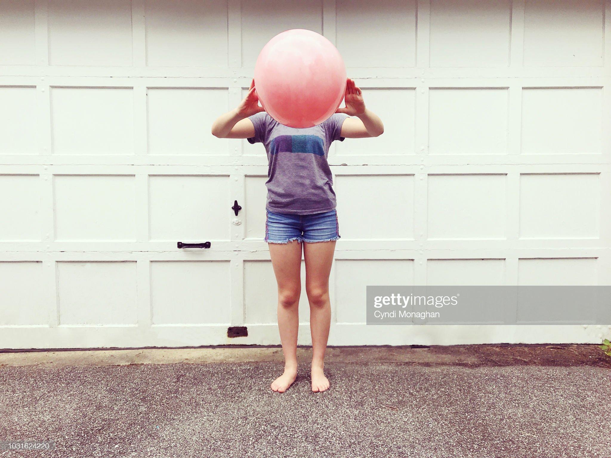 Girl with Bouncy Ball Head : Stock Photo