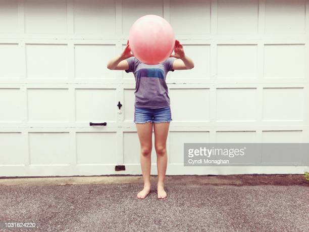 girl with bouncy ball head - naughty america stock pictures, royalty-free photos & images