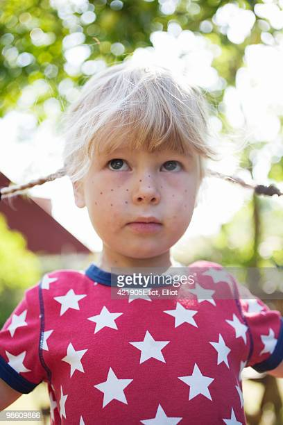Girl with braids and fake freckles, Sweden.