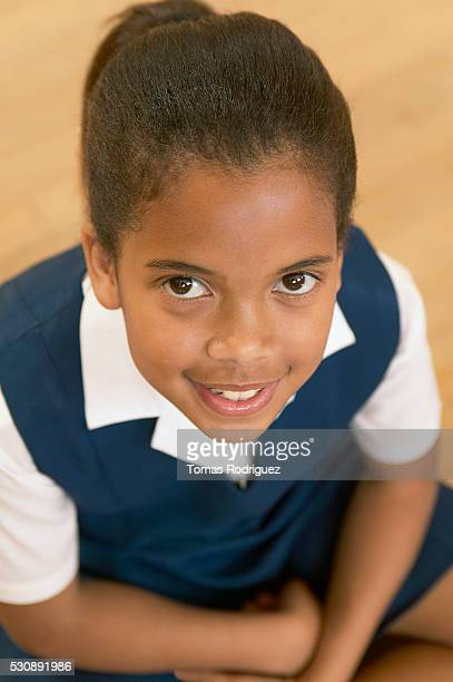 Girl with brown eyes wearing school uniform