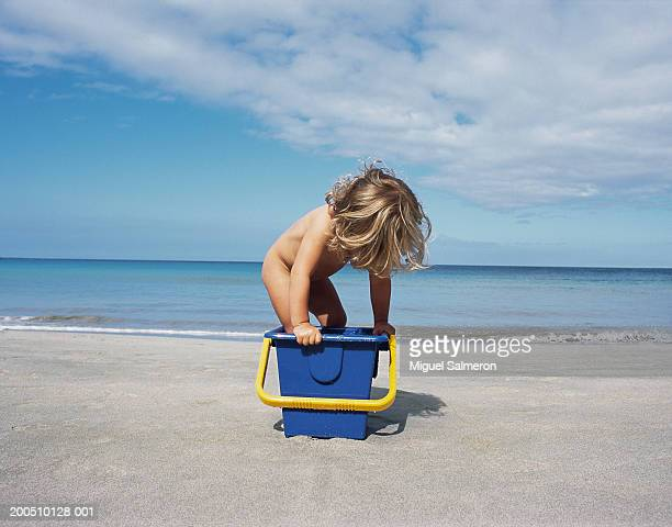 Girl with bucket on beach