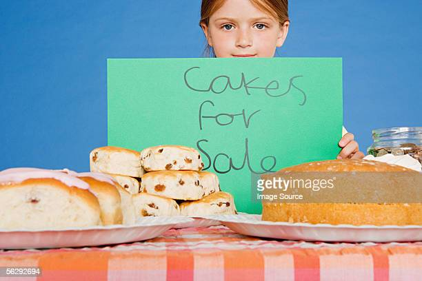 Girl with cake stall