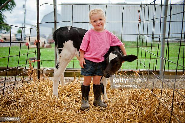 Girl with calf.