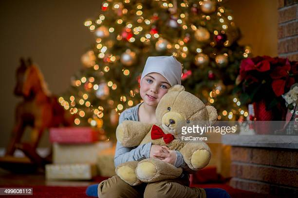 Girl with Cancer Holding Her Teddy Bear
