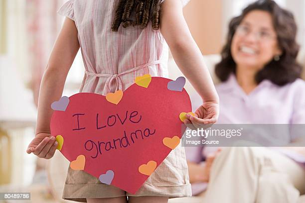 girl with card for grandma - mothers day card stock pictures, royalty-free photos & images