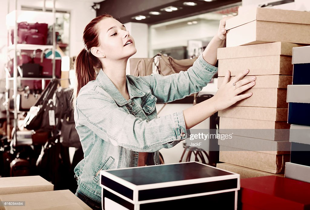 girl with carton packages in bags shop : Foto de stock