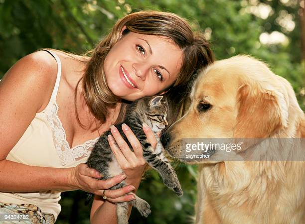 Girl with cat and dog