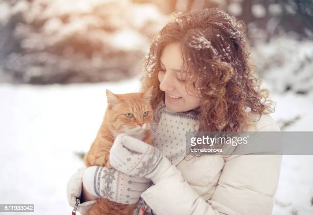 Girl with cat outdoors