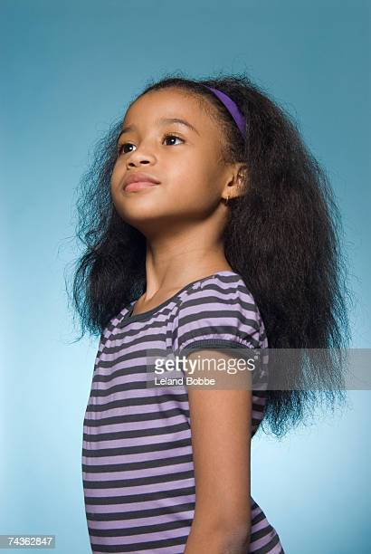 Girl (8-9) with chin up, side view