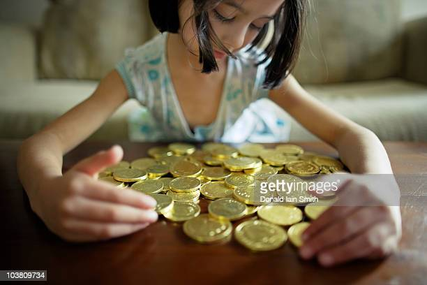 girl with chocolate coins - greedy smith stock pictures, royalty-free photos & images
