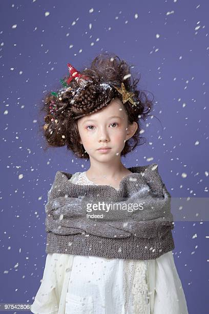 A girl with christmas decorations in hair