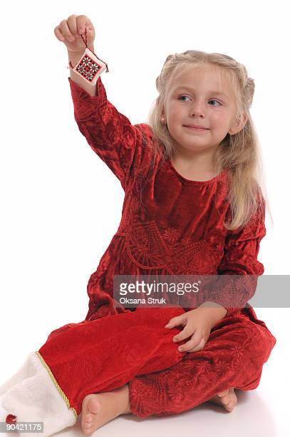 girl with christmas stocking - stockings no shoes stock pictures, royalty-free photos & images