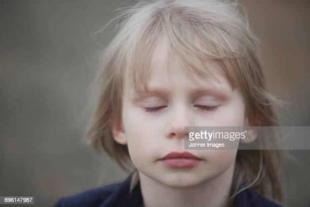 Girl with closed eyes