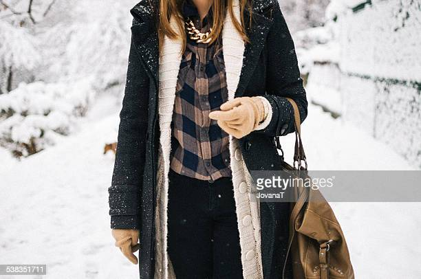 Girl with coat and sweater