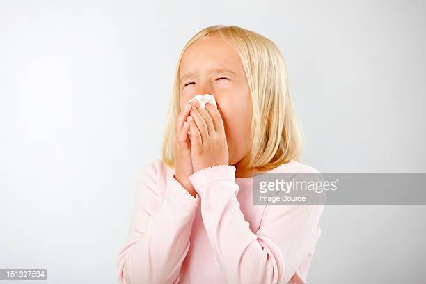 Girl with cold blowing nose