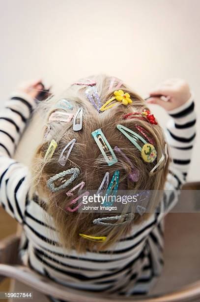 girl with colorful hairpins - hair clip stock pictures, royalty-free photos & images