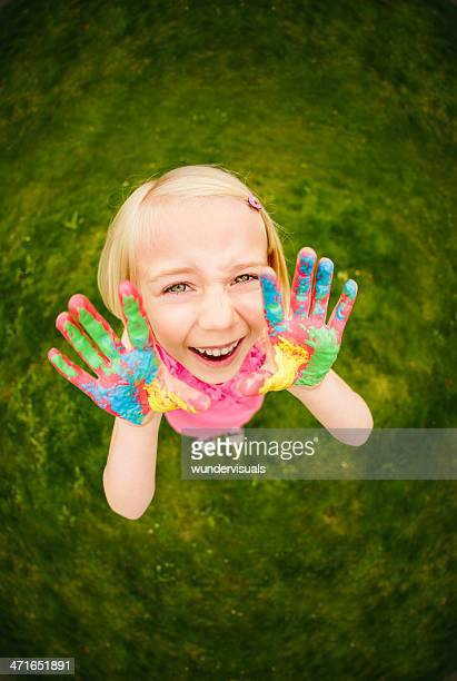 Girl with colorful hands shouting at camera