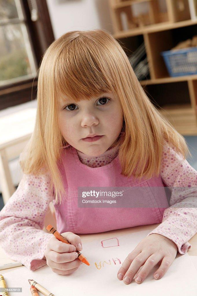 Girl with crayon : Stockfoto