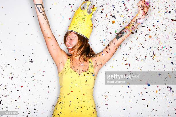 Girl with Crown Celebrates with Confetti
