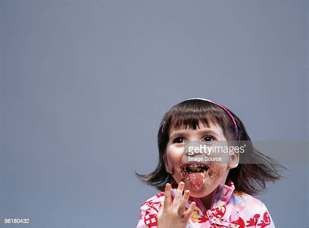 Girl with crumbs round her mouth