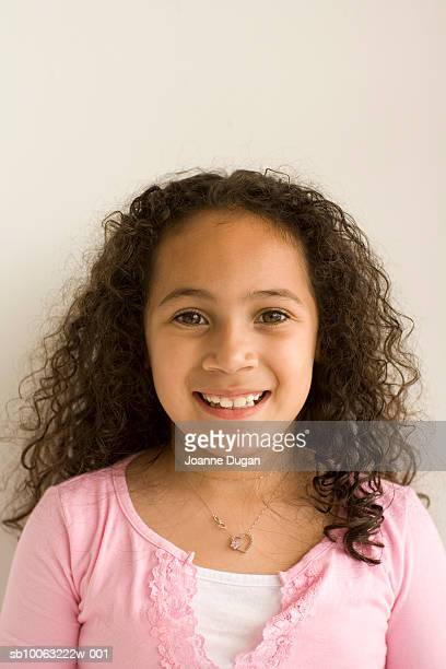 girl (8-9 years) with curly hair, smiling, portrait - 8 9 years stock pictures, royalty-free photos & images
