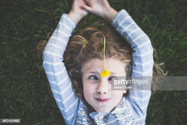girl with dandelion on her head - girl nerd hairstyles stock photos and pictures
